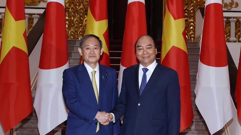 Thủ tướng Nguyễn Xuân Phúc và Thủ tướng Nhật Suga Yoshihide tại Phủ Chủ tịch sáng 19/10 - Ảnh: TTXVN.