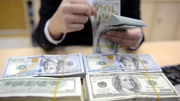 Lượng kiều hối năm 2020 được dự báo giảm còn 15,7 tỷ USD. Ảnh: QP.