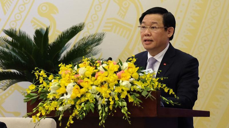 Phó thủ tướng Vương Đình Huệ giới thiệu dự thảo Nghị quyết 01/2018 của Chính phủ.