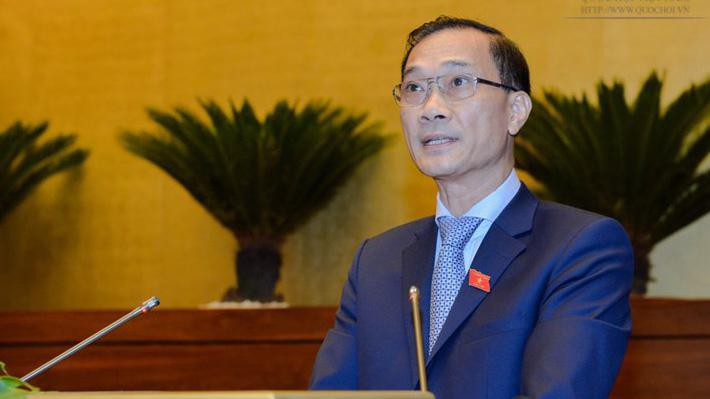 Chủ nhiệm Uỷ ban Kinh tế Vũ Hồng Thanh trình bày báo cáo giải trình, tiếp thu dự án luật.