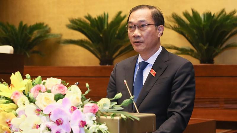 Chủ nhiệm Uỷ ban Kinh tế Vũ Hồng Thanh trình bày báo cáo thẩm tra - Ảnh: Quang Phúc.