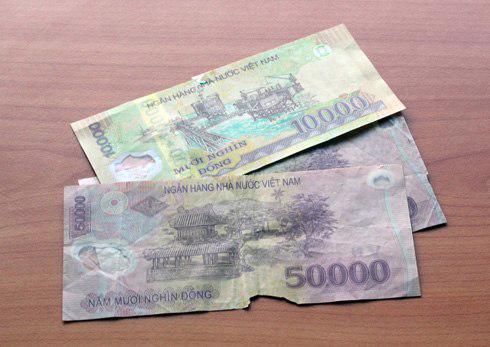 Cử tri phản ánh đến Ngân hàng Nhà nước về chất lượng của đồng tiền đang lưu thông hiện nay - Ảnh: Nhật Minh.<br>