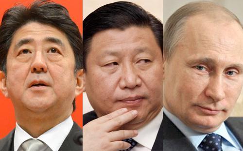 Thủ tướng Nhật Bản Shinzo Abe (bên trái), Chủ tịch Trung Quốc Tập Cận Bình (giữa) và Tổng thống Nga Vladimir Putin.<br>