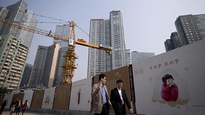 Rủi ro giảm phát, dư thừa công suất, và mức nợ cao đang phủ bóng lên nền kinh tế Trung Quốc - Ảnh: Reuters.<br>