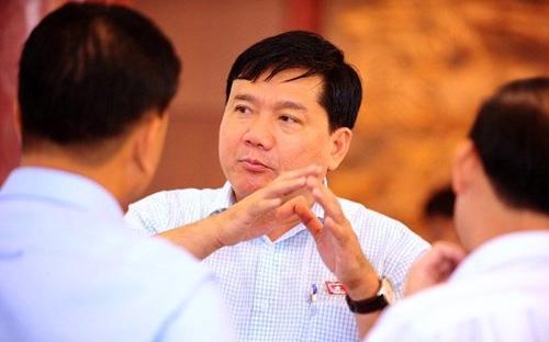 Bộ trưởng Bộ Giao thông Vận tải Đinh La Thăng (giữa) - Ảnh: Pháp luật Tp.HCM.