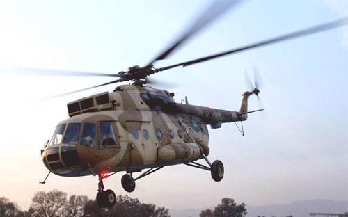 Một trực thăng quân sự Mi-17 của Pakistan hạ cánh ở Islamabad - Ảnh: AP/WSJ.<br>