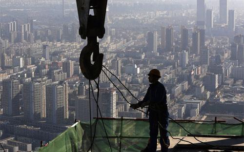 Thống kê cho thấy, doanh số bán nhà ở Trung Quốc trong 9 tháng đầu năm giảm 10,8% - Ảnh: Reuters.<br>