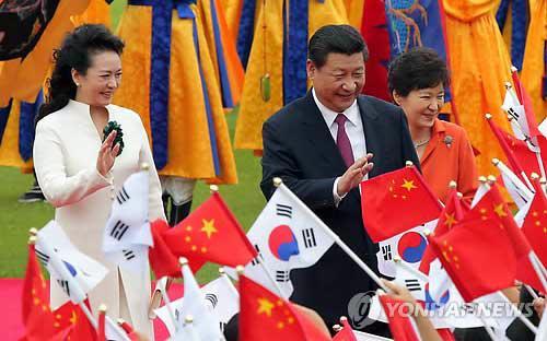 Hồi đầu tháng 7 năm nay, lần đầu tiên một chủ tịch nước của Trung Quốc đến thăm Hàn Quốc trước khi sang Triều Tiên - Ảnh: Yonhap.<br>