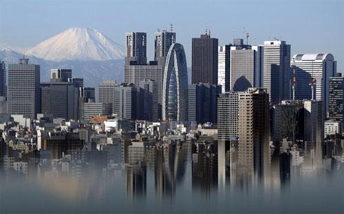 Trong số các nền kinh tế phát triển, kinh tế Nhật có mức tăng trưởng đuối nhất trong quý 4 - Ảnh: Bloomberg.<br>