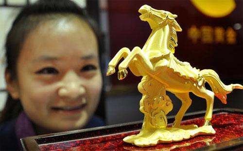 Tốc độ tiêu thụ vàng của Trung Quốc năm nay có thể giảm nhiệt so với năm ngoái, nhưng mức giảm sẽ không lớn - Ảnh: China Daily.<br>