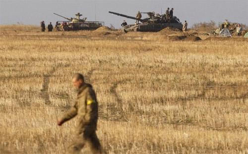 Hôm thứ Bảy tuần trước, chính quyền Kiev và lực lượng ly khai đã nhất  trí thiết lập một vùng đệm ở miền Đông Ukraine - Ảnh: AFP.<br>