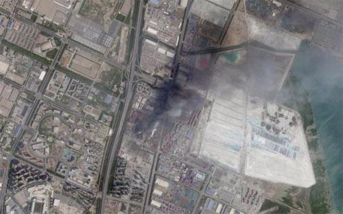 Ảnh chụp từ vệ tinh sau vụ nổ ở Thiên Tân, Trung Quốc ngày 12/8 - Ảnh: Reuters.<br>