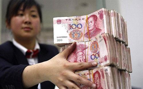 Đợt phá đồng tiền quy mô lớn đầu tiên của Trung Quốc kể từ năm 1994 đã khiến thị trường tài chính toàn cầu bị sốc - Ảnh: Bloomberg.<br>