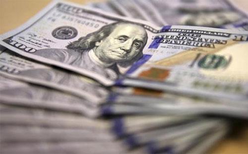 Chỉ số Dollar Index, thước đo sức mạnh đồng USD so với một rổ tiền tệ, giảm xuống mức thấp nhất kể từ cuối tháng 8 - Ảnh: Reuters.<br>