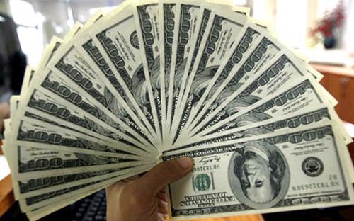 Trong lần tăng tỷ giá chính thức này, Ngân hàng Nhà nước điều chỉnh tỷ  giá bình quân liên ngân hàng từ mức 21.458 VND/USD lên 21.673 VND/USD,  tương đương mức điều chỉnh tăng 1% - Ảnh: Reuters.