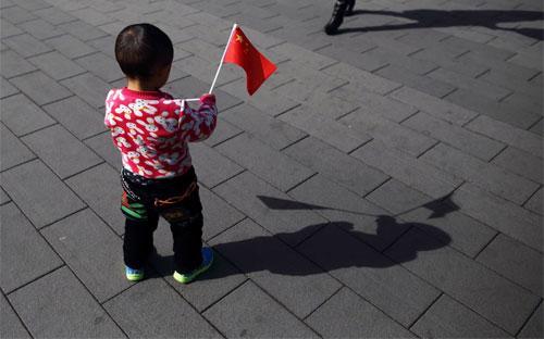 """EIU nhận định, sức mạnh kinh tế ngày càng lớn của hai """"gã khổng  lồ"""" châu Á là Trung Quốc và Ấn Độ sẽ đi kèm với ảnh hưởng chính trị lớn  hơn - Ảnh: Bloomberg.<br>"""