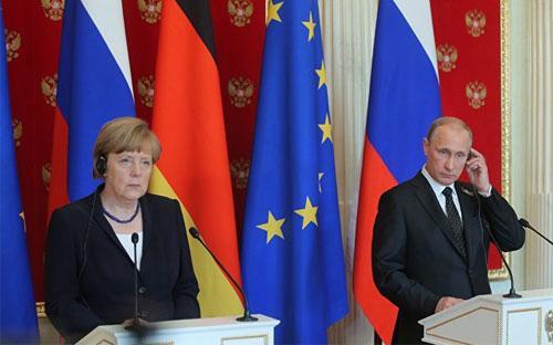 Thủ tướng Đức và Tổng thống Nga tại cuộc họp báo ở Moscow - Ảnh: Sputnik News.<br>