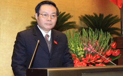 Chủ nhiệm Ủy ban Tài chinh - Ngân sách trình bày báo cáo thẩm tra quyết toán ngân sách nhà nước năm 2013.