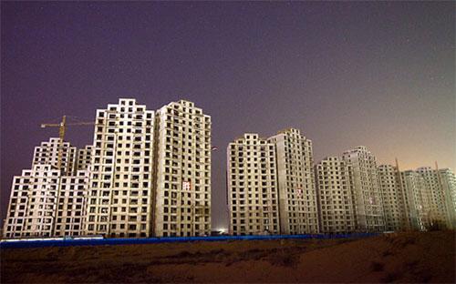 """Theo các nhà phân tích, tình trạng suy sụp của thị trường bất động sản  biến hơn một chục thành phố của Trung Quốc thành """"thành phố ma"""" - Ảnh: Time.<br>"""