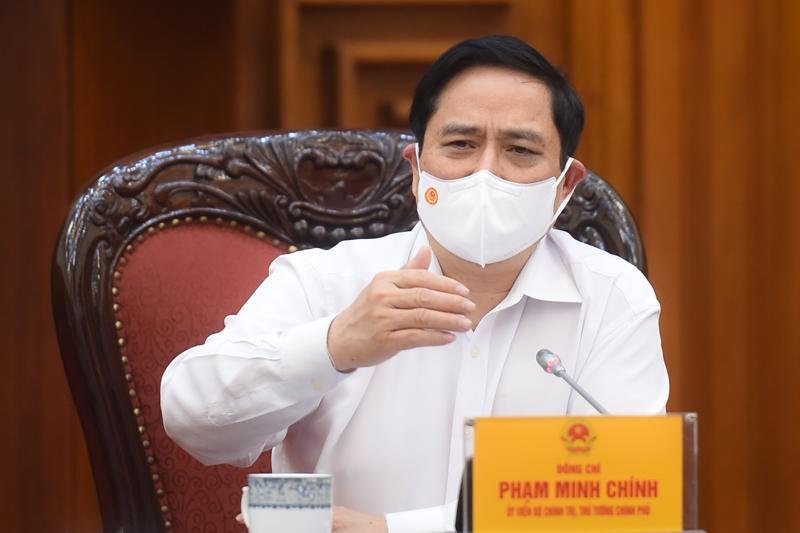 Thủ tướng Chính phủ Phạm Minh Chính chủ trì buổi làm việc với lãnh đạo Bộ Giao thông vận tải - Ảnh: VGP