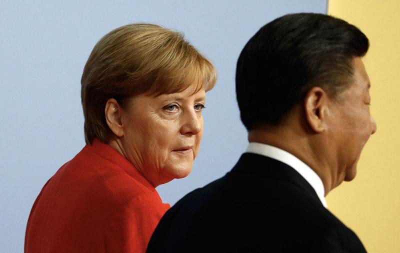 Thủ tướng Đức Angela Merkel và Chủ tịch Trung Quốc Tập Cận Bình - Ảnh: Getty.