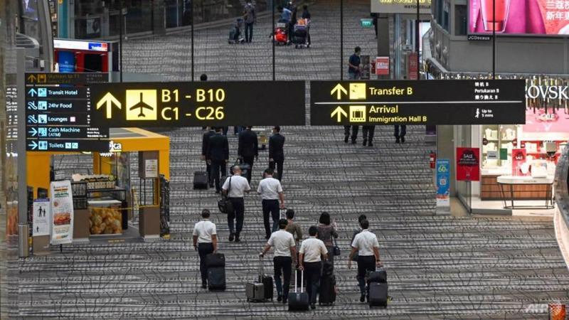 Hành khách tại sân bay Changi, Singapore ngày 14/1 - Ảnh: AFP/Getty Images.