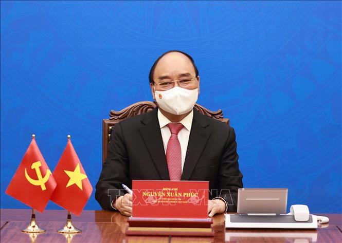 Chủ tịch nước Nguyễn Xuân Phúc tại cuộc điện đàm với Tổng Bí thư, Chủ tịch Trung Quốc Tập Cận Bình chiều 24/5 - Ảnh: TTXVN.