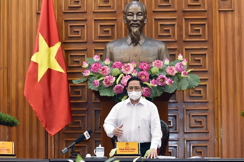 Thủ tướng Chính phủ Phạm Minh Chính tại cuộc họp của Thường trực Chính phủ về phòng chống Covid-19 chiều 24/5 - Ảnh: VGP