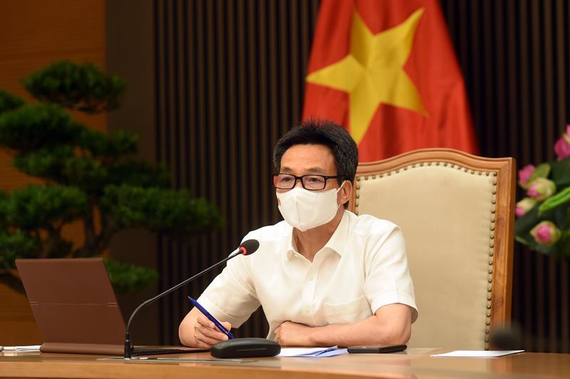 Phó Thủ tướng Vũ Đức Đam họp trực tuyến với tỉnh Bắc Giang và Bắc Ninh chiều 7/6. Ảnh - VGP/Đình Nam.