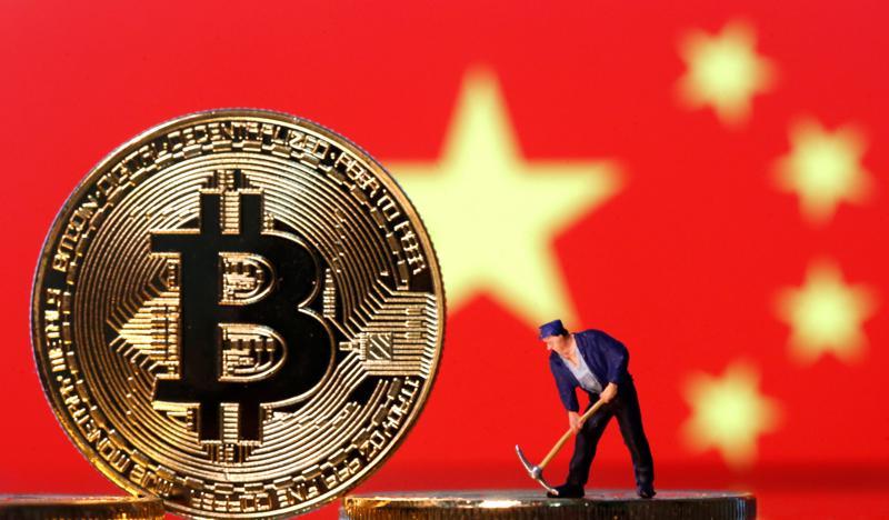 Ngày càng nhiều người trẻ Trung Quốc ôm mộng đổi đời với tiền ảo - Ảnh: Reuters.