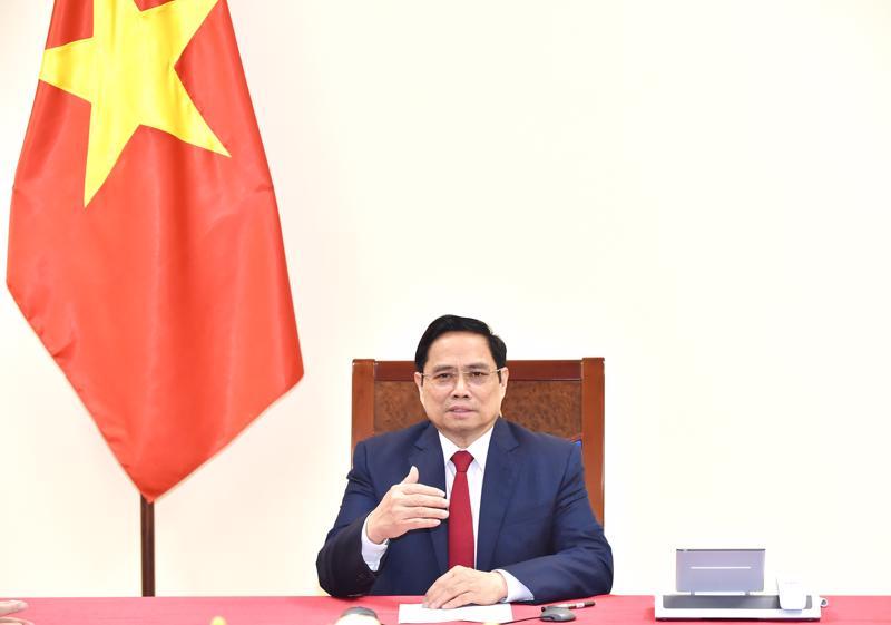 Thủ tướng Phạm Minh Chính điện đàm với Tổng Giám đốc WHO - Ảnh: VGP