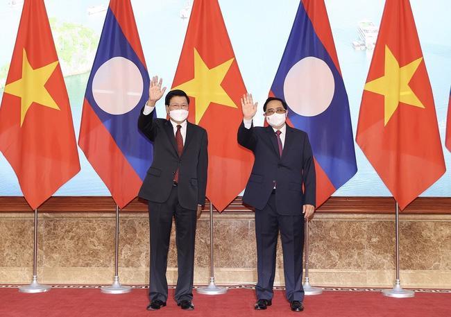 Thủ tướng Chính phủ Phạm Minh Chính hội kiến Tổng Bí thư, Chủ tịch nước Lào - Ảnh: TTXVN.