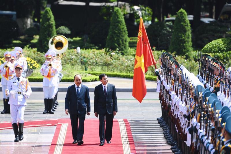 Chủ tịch nước Nguyễn Xuân Phúc và Tổng Bí thư, Chủ tịch nước Lào Thongloun Sisoulith - Ảnh: VGP