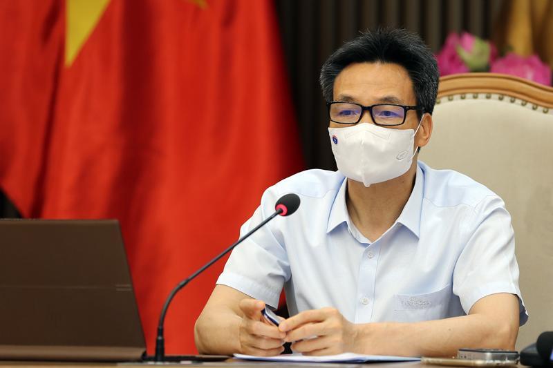 Phó Thủ tướng Vũ Đức Đam họp trực tuyến với lãnh đạo hai tỉnh Bắc Ninh và Bắc Giang. Ảnh - VGP/Đình Nam.