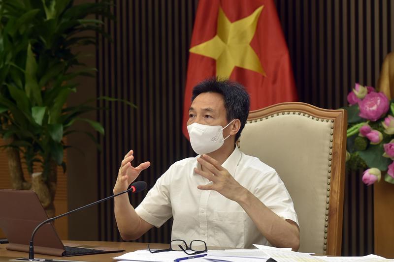 Phó Thủ tướng Vũ Đức Đam chủ trì cuộc họp trực tuyến với TP.HCM sáng 5/7. Ảnh - VGP/Đình Nam.