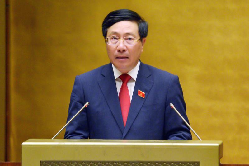 Ủy viên Bộ Chính trị, Phó Thủ tướng Chính phủ Phạm Bình Minh báo cáo tại kỳ họp thứ nhất Quốc hội khóa XV sáng 22/7 - Ảnh: Quochoi.vn