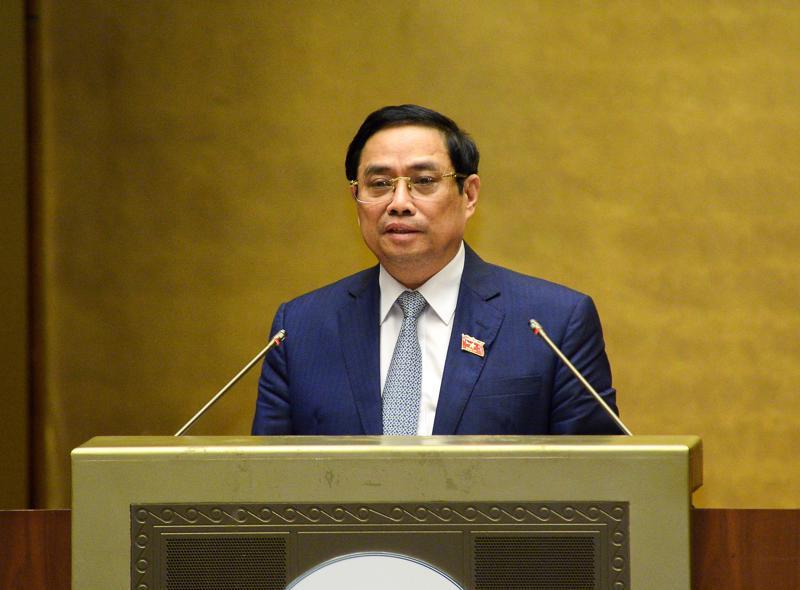 Thủ tướng Chính phủ nhiệm kỳ 2016-2021 Phạm Minh Chính trình bày Tờ trình về cơ cấu tổ chức của Chính phủ nhiệm kỳ Quốc hội khóa XV - Ảnh: Quochoi.vn