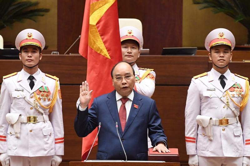 Chủ tịch nước Nguyễn Xuân Phúc tuyên thệ nhậm chức ngày 26/7 - Ảnh: TTXVN