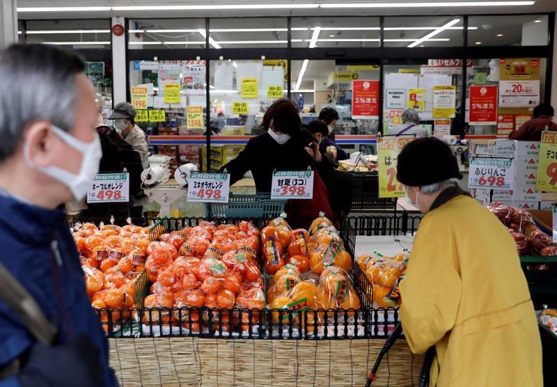 """Biến thể Delta phủ """"bóng đen"""" lên triển vọng kinh tế Nhật Bản - Ảnh: Reuters"""