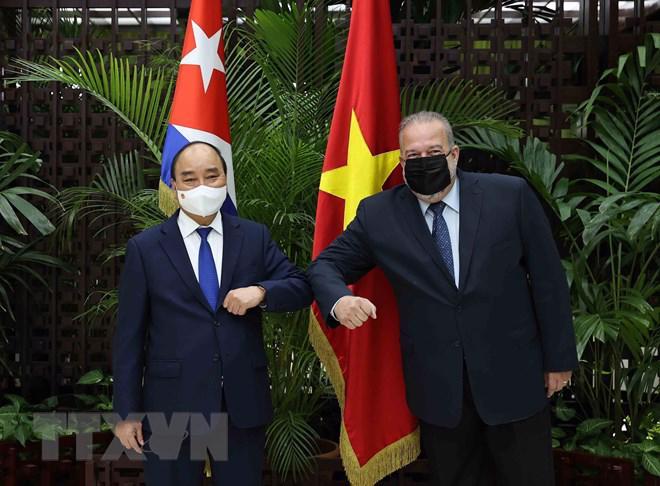 Chủ tịch nước Nguyễn Xuân Phúc và Thủ tướng Cuba Manuel Marrero Cruz - Ảnh: TTXVN