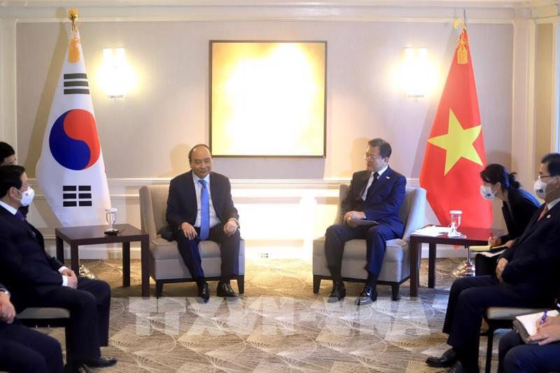 Chủ tịch nước Nguyễn Xuân Phúc hội đàmTổng thống Hàn Quốc Moon Jae-in - Ảnh: TTXVN