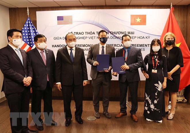 Chủ tịch nước Nguyễn Xuân Phúc chứng kiến lễ trao thỏa thuận hợp tác giữa Chân Mây LNG và đối tác - Ảnh: TTXVN
