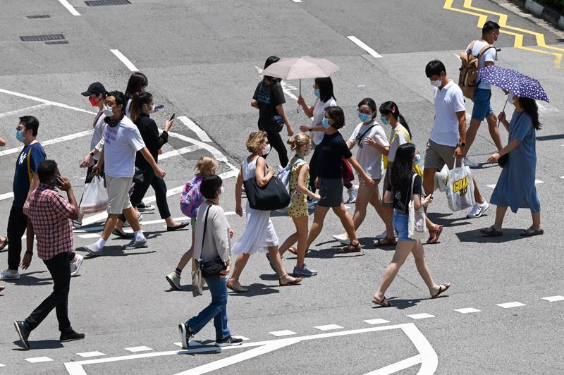 """Singapore đã chuyển từ chiến lược """"không Covid"""" sang """"sống chung với Covid"""" - Ảnh: AFP/Getty Images"""