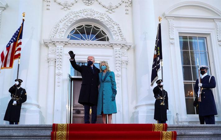 Chứng khoán Mỹ cao kỷ lục ngày ông Biden nhậm chức - Ảnh 1.