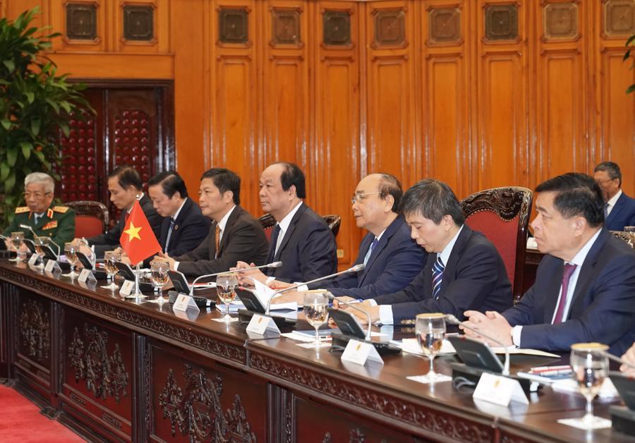 Thủ tướng Nguyễn Xuân Phúc đón và hội đàm với Thủ tướng Nhật Bản - Ảnh 10.