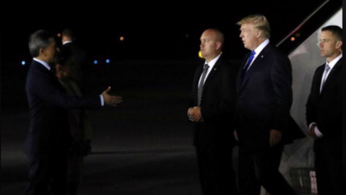 Những hình ảnh đầu tiên của ông Trump và ông Kim Jong Un ở Singapore - Ảnh 2.
