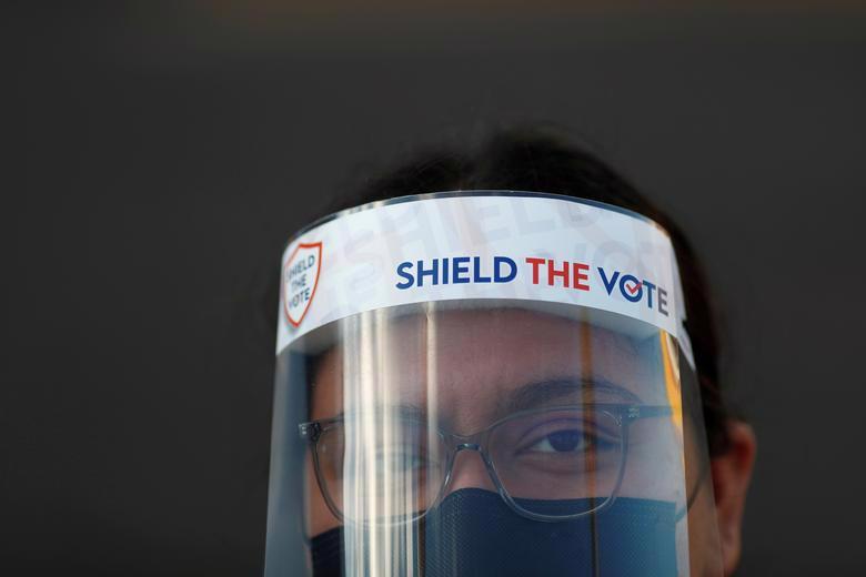 Người Mỹ đi bỏ phiếu chọn Tổng thống, ngày bầu cử êm xuôi - Ảnh 17.