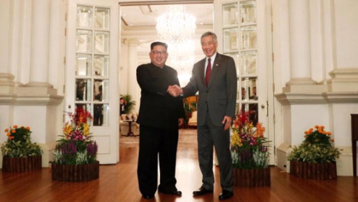 Những hình ảnh đầu tiên của ông Trump và ông Kim Jong Un ở Singapore - Ảnh 5.