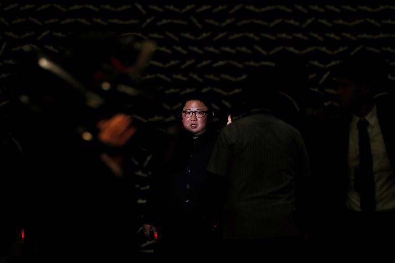 Chùm ảnh ông Kim Jong Un đi dạo đêm ở Singapore - Ảnh 6.