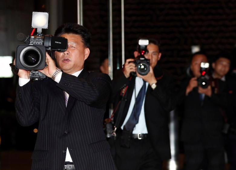 Chùm ảnh ông Kim Jong Un đi dạo đêm ở Singapore - Ảnh 9.